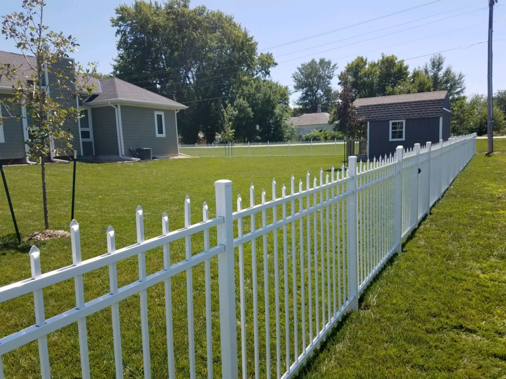 White ornamental fence with an alternating picket design